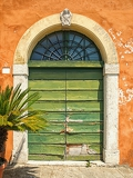 Fotografie old door of tuscany in italy
