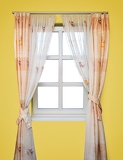 Fotografie yellow room with stripped looking through a window