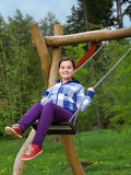 happy girl on a swing in the playground