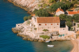 aerial view of on little romantic inlet and old house