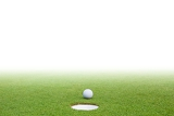 Fotografie golf ball on green grass and white background