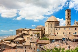 view of the roofs of a small town volterra  in tuscany italy