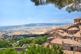 view of the roofs and  landscape of a small town volterra in tuscany italy