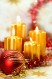 the burning candles balls and gold ribbons it are christmas