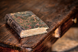 old book on the wooden table