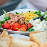 tasty salad with tuna tomato and corn