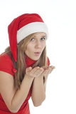 Fotografie photo of christmas girl blowing wishes