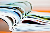 stack of open magazine  soft focus