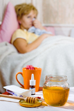 young ill woman with cup of tea