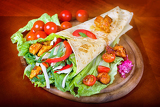 healthy summer meal grilled chicken and vegetables wrapped in a whole wheat tortilla