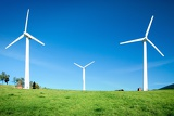 Photo green meadow with wind turbines generating electricity