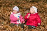 Fotografie two little girls blowing bubbles in the park