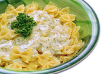 fresh hot spaghetti with cheese sauce with parsley