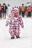 portrait of cute baby overalls in winter wintertime