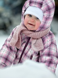 cute baby is smiling outdoor snow winter christmas time