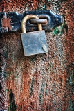 old rusty padlock hanging on the door