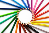 assortment of colored pencils with shadow on white background  colored crayons