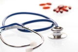 a shallow dof image of a stethoscope on white background