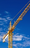 hoisting crane against a background sky