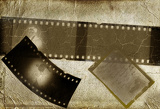 Fotografia retro photo framework against an old paper with filmstrip