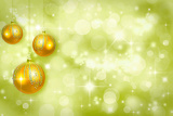 Fotografia yellow christmas ornaments on a green background defocused