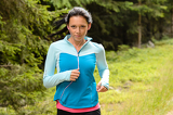 Fotografia Running woman in forest  fitness training