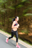 Fotografia Young woman running outdoors motion blur