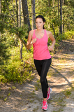 Fotografia Athlete woman running through forest training