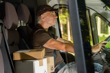 Fotografia Courier man driving cargo car delivering package