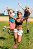 Cheerful friends jumping enjoy summer sport run