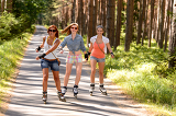 Fotografie Three friends on in-line skates outdoor