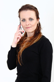 Fotografia the attractive woman talks by a mobile phone on a white background