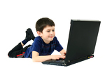 small boy playng game on laptop on a white background