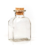 Fotografia blank glass bottle with cork stopper on white