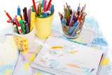 abstract painting  and pen holders  with colored pens on a white background