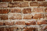 toned red brick wall grunge background or texture