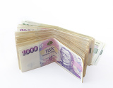 Photo volume of czech banknotes nominal value one thousand crowns on white background