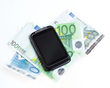 Fényképek modern mobile smart phone and  euro banknotes on white background