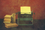 Photo old typewriter with paper and books retro colors on the desk