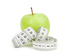Fotografie measuring tape and green apples as a symbol of diet on white background
