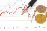 Fotografie stock market graphs with black pen and euro coins
