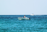 a white speedboat on open sea in the croatia