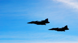 two aircraft jas 39 gripen on blue sky