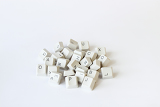 scattered keyboard keys on white background