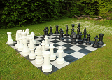 big outdoor chess in green lawn in sunny day