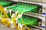 Photo green singlemode sc connectors connected to patch panel