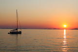 romantic sunset with silhouette of yacht