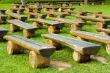 outdoor wood seating on green lawn