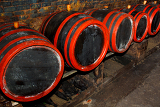 Fotografie wine barrels stacked in the old cellar of the winery