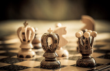 Photo chess with focus to black king and queen